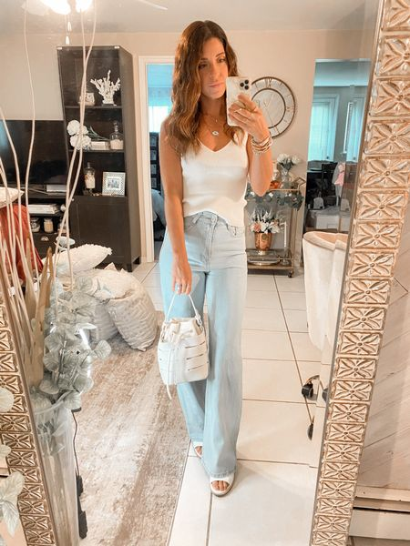 Basics 🤍  Wide leg jeans and a knit white top   #LTKunder50 #LTKitbag #LTKSeasonal