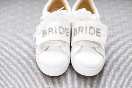 Wedding bridal white satin sneakers #betseyjohnson #wedding #bride  #LTKshoecrush #LTKSeasonal #LTKwedding