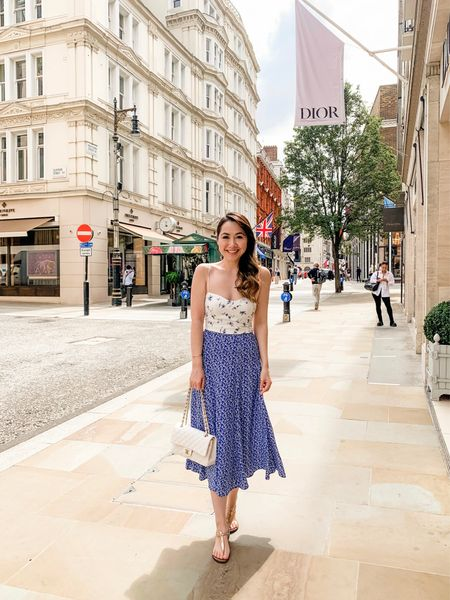 Easy summer style - printed blue floral midi skirt with a contrasting print white floral printed cami top. Just paired with a white Chanel bag and my favourite, super comfortable flat thong sandals!   #LTKunder50 #LTKeurope #LTKunder100