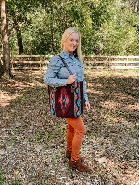 Size up in the top! I am wearing a medium. This top is top notch quality! The feminine shoulder detail, mother of pearl RL snaps, and quality denim make this a piece I'll keep forever. My bag is wool, and I adore it!  #LTKshoecrush #LTKitbag #LTKunder100