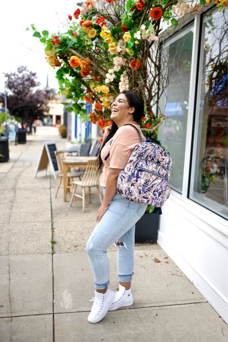 """Vera Bradley new print in tangier paisley + new fall favorites! Use code """"queencarlene"""" for 10% off   Shirt is aerie (L), jeans are seven (31, TTS), & shoes are converse (size down 1.5 sizes)  Vera Bradley collection, travel essentials, #verabradley, travel must-haves, backpacks, floral bags, Vera Bradley travel, casual style, midsize, mid size, aerie, light denim jeans, converse, high rise denim, size 12, size 14, high tops   #LTKunder100 #LTKSeasonal #LTKitbag"""