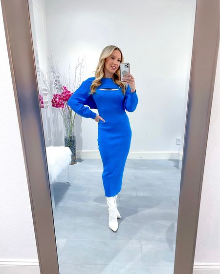 """Sweater dresses & sweater sets are my Fall outfit go to. This blue knit sleeveless midi sweater dress comes is actually a 2 piece dress & shrug set & perfect for layering. I prefer it with white knee high boots to black to keep it bright & fresh. Sizing runs true to size but looks longer than me as I'm 5'2"""".   #LTKSeasonal #LTKstyletip #LTKworkwear"""