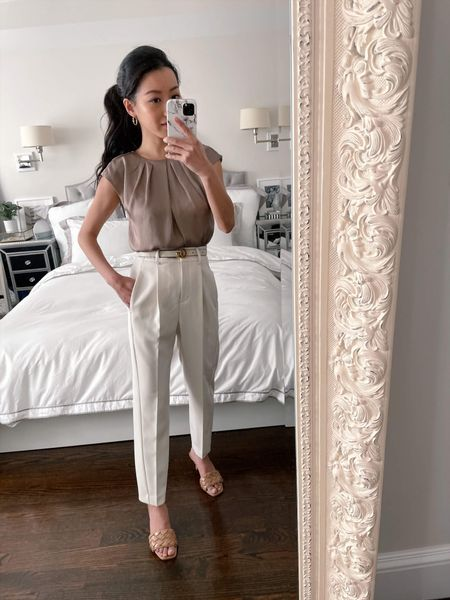 Spring workwear // Styling these petite friendly high waisted trousers for a chic, neutral toned outfit.   •Express drapery cap sleeve blouse xxs •High waisted ankle pants 00 petite •Quilted sandals 6 •Gucci belt 70cm Would also pair this with the drapey cami linked for a dressier or evening look!  http://liketk.it/3dZik #liketkit @liketoknow.it   #LTKSeasonal #LTKworkwear