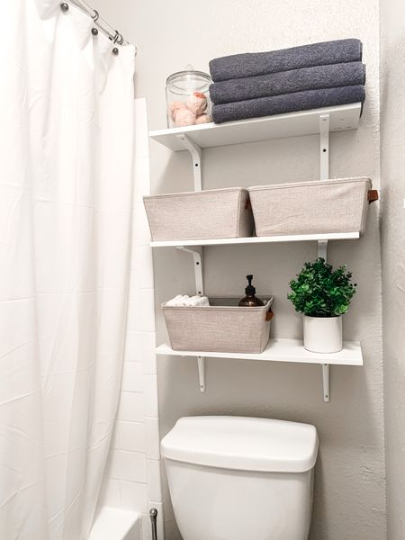 Easy and decorative solution for small bathrooms with minimal storage! Love how affordable these shelves are and how the baskets aesthetically hold extra toilet paper, feminine higiene products, wash cloths, and cleaners!  #LTKstyletip #LTKunder50 #LTKhome