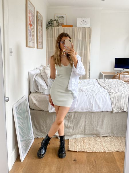 This knit dress is such a perfect piece for festival dressing! I've layered a white shirt over the top for a casual summer look    #LTKeurope