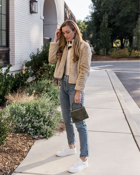 Faux fur jacket (size small) with straight leg jeans (TTS) and white sneakers (TTS) for a casual fall outfit. My jacket is under $100 and perfect for easing into cooler weather! Bag is old, two similar from brands I love linked.  #falloutfitscasual #casualfalloutfits #straightlegjeans #fauxfurjacket