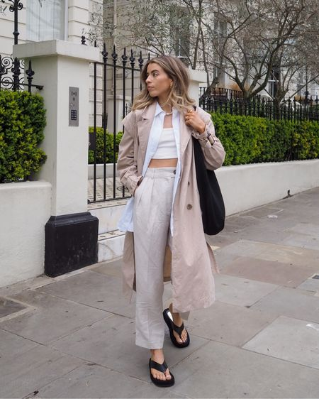 Spring layers including this H&M trench, Linen trousers and these black flip flop sandals     #LTKSeasonal #LTKeurope