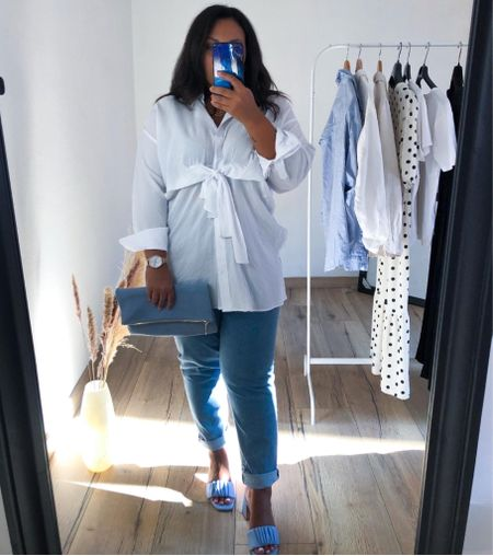 Long sleeve shirt with knot at the front height waisted loose fit jeans matching blue bag and heels   #curves #curvy #curvyoutfit #curvystyle #transitionaloutfits #falllooks #midsize #midsizefashion #midsizestyle #momjeans   #LTKcurves #LTKSeasonal #LTKfit