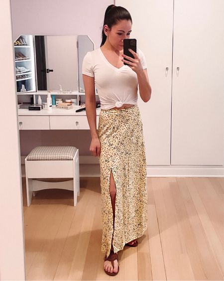 This floral maxi skirt is definitely one of my new favorites! I love the pale yellow color and the floral pattern. I'm excited to style this many different ways, but I also love the way I'm wearing it here with a white V-neck T-shirt tied in the front and some neutral sandals.   #LTKunder50 #LTKstyletip #LTKSeasonal