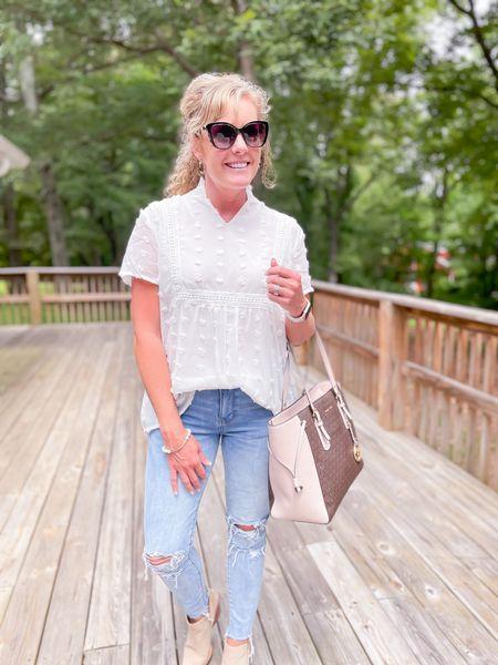 White blouse lose fit size medium fits TTS / distressed jeans fit TTS wearing size 4 / Michael Kors bag / booties fit TTS    #LTKunder50 #LTKshoecrush #LTKstyletip