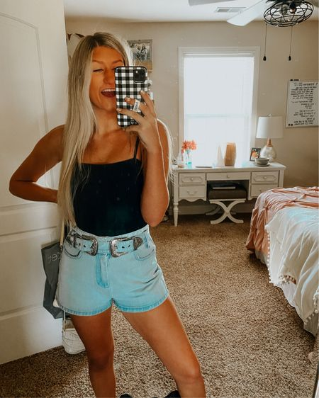 The cutest way to style a black tank bodysuit is with some cute jean shorts for the summer! I love this western belt paired with it! Only $30 for the bodysuit, y'all! #LTKunder50 #LTKstyletip #LTKfit http://liketk.it/3j94X #liketkit @liketoknow.it Shop your screenshot of this pic with the LIKEtoKNOW.it shopping app