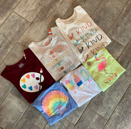 Cute new tees and tanks for girls at Target — Cat & Jack + Art Class! . . . . . .  Kid // kids // spring style // kids clothes // target kids // art class // cat and jack // cat & jack // tees // graphic tees // unicorn // ice cream // rainbows // summer tees // tshirt // t-shirt // st patty's day // at Patrick's day // kid tees // kid clothes // play clothes // flowers // tie dye // target kids // target // target sale // shoes // kid shoes // boys // boy // sneakers // sandals // Mermaids // tennis shoes // kids shoes // shoe sale // mermaid shoe // rainbow shoe // sandals // shark // sharks // shark shoe // bootie // lion // fire truck // kid romper // baby romper // boys clothes // baby clothes // target baby // baby boy clothes // baby girl clothes // Jean shorts // shorts // boy shorts // girl shorts // toddler clothes // shark pants // dinosaur romper // kids tees // kids graphic tees // back to school // tanks // tank top // autumn tee // Target kids // Target girls // art class Target // cat and Jack target // romper // Onesie // baby boy romper //   #LTKkids #LTKbaby #LTKfamily