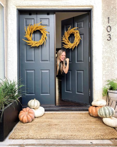 """Yesss...it's the first day of FALL! Yesss...for another """"pile all the pumpkins and call it good"""" decor! Yesss...I am finally going to share my STAIR OPTIONS and plans today in stories! . Also, I vote fall is the BEST season. Do you agree?...or kindly disagree? . 👉🏻 $200 front porch door makeover for the win (poop brown door before in stories)!   http://liketk.it/2Fbyp #liketkit @liketoknow.it"""