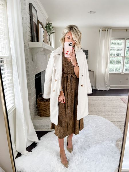 Loverly Grey has paired this printed dress with an oversized coat for a fall work wear look!   #LTKstyletip