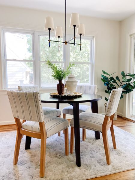 Cute breakfast nook with round table and modern farmhouse dining chairs.  Black chandelier with shades, kitchen table, upholstered dining chairs, round wood dining table, kitchen decor, home decor  #LTKhome