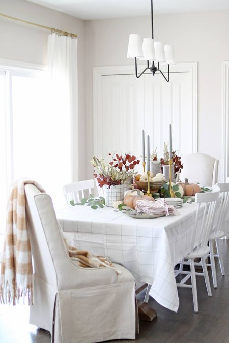I always love setting a fall table! Never mind that it's supposed to be 95 here today (the hottest October day on record for us) 😅 But the scenes of the season are still beautiful - especially in a neutral palette! Get tips and tricks for the perfect fall table at courtneymbrowning.com or shop our dining room in the @shop.LTK app!   #LTKhome #LTKSeasonal