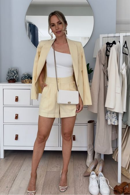 I'm 5'5 and I'm wearing a size U.K. 6 in the Peale yellow blazer and a U.K. 4 in the shorts.  The blazer is true to size, however I would size down in the shorts.  My bag is the white chevron caviar Chanel wallet on chain with light gold details   My pure star white sneakers are true to size.  The big bag and the white pumps are unfortunately old, so I have linked some similar ones.    #LTKSeasonal #LTKstyletip #LTKDay