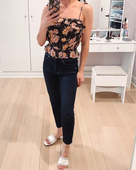 New floral top from American eagle and I love the paler color of the flowers. It's a little cropped and fitted at the waist to be flattering. Paired with express cropped jeans and Steven New York chain sandals.   #LTKstyletip #LTKunder50 #LTKshoecrush
