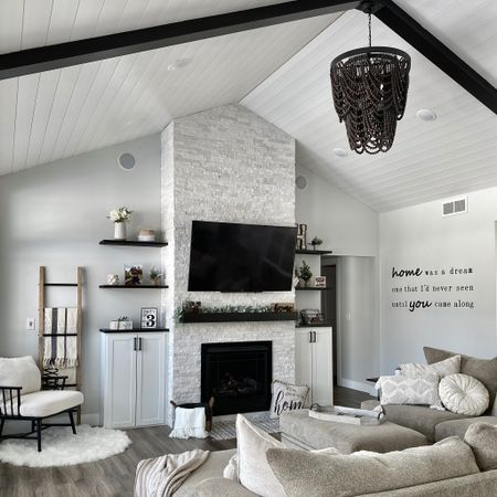 Boho living room vibes 🖤 it's coming together! We still want to put a vertical black beam across the ceiling, but loving it so far. #livingroomdecor #boholivingroom #blackandwhitedecor #greatroom http://liketk.it/38PJs #liketkit @liketoknow.it