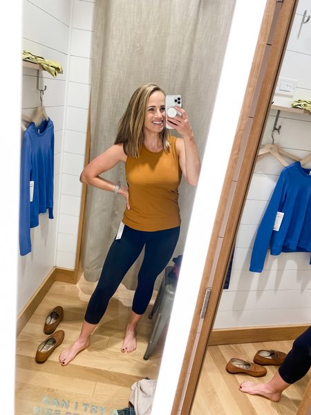 I absolutely love this mustard color workout tank! It's perforated, so super breathable. And not too tight!