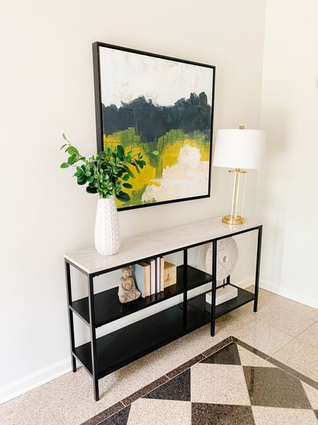Love this bright art over the modern console in the home's entryway.  Console table, abstract art, entryway, home decor, large art, gold and glass lamp    #LTKhome
