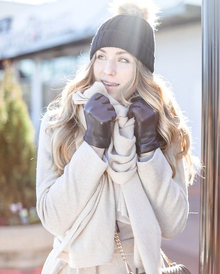 Neutral winter look // Cole Haan wrap coat in bone, black pom beanie, J. Crew tech gloves size M, Everlane denim, Everlane western boot http://liketk.it/2IQnJ #liketkit @liketoknow.it #LTKunder100