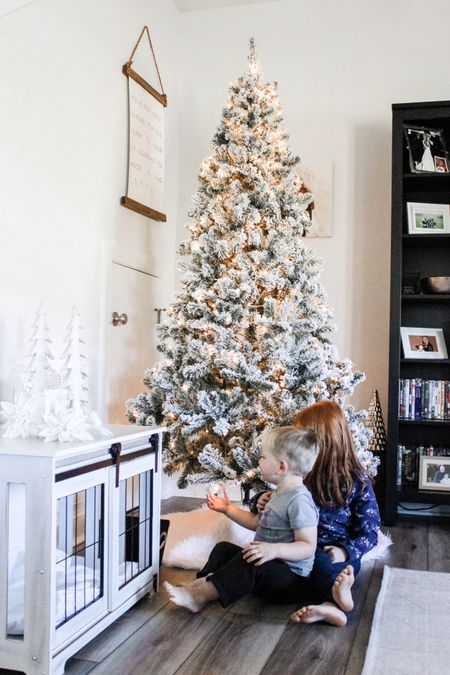 In love with the 7ft Prince Flocked Tree with lights from King of Christmas. It is on sale too! #christmastree  #LTKsalealert #LTKhome #StayHomeWithLTK