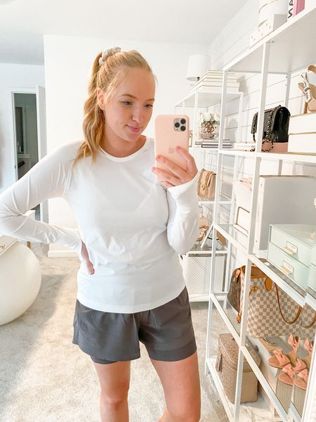New activewear lunch at Spanx! These shorts are very flattering and come in three colors. Wearing a size medium in top and bottom. Use code AMANDAJOHNxSPANX for 10% off  #workouttop #workoutshorts #athleticshorts   #LTKfit