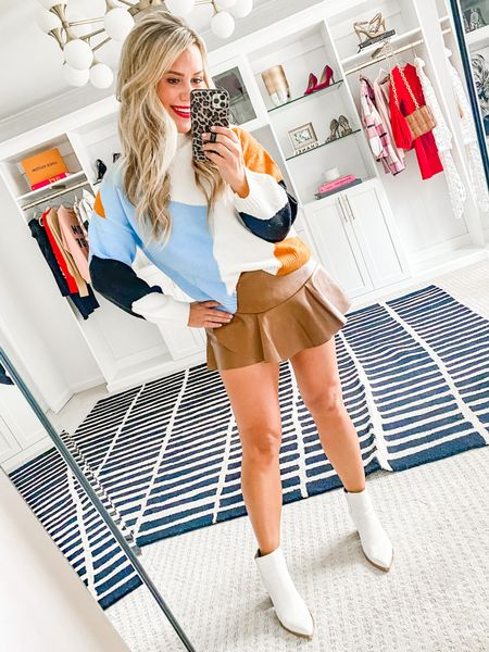 15% off my sweater & skort with LAUREN15. Wearing a small sweater and a medium skirt.