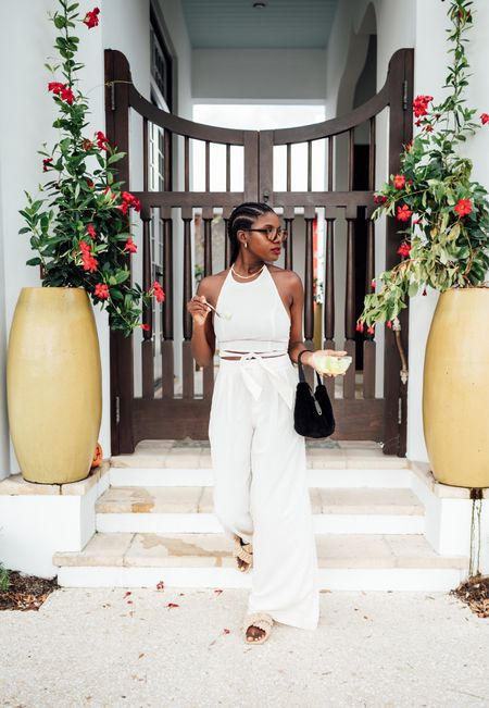Vacation outfit! White Halter top with wide leg pants as a set. Great travel outfit thank !  #LTKunder50 #LTKtravel #LTKstyletip
