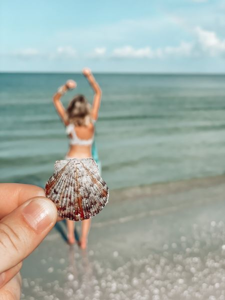 Pretty sure my birthstone is actually a seashell 😏🐚🌅  Swipe over >> to see our shelling haul! Dave pulled his weight (for once 😉) and found 2 flat scallops, the majority of those sand dollars, and the big alphabet cone!   There's nothing sexier than a man who will comb a sand bar for sand dollars for you 😏😏    #LTKswim #LTKtravel