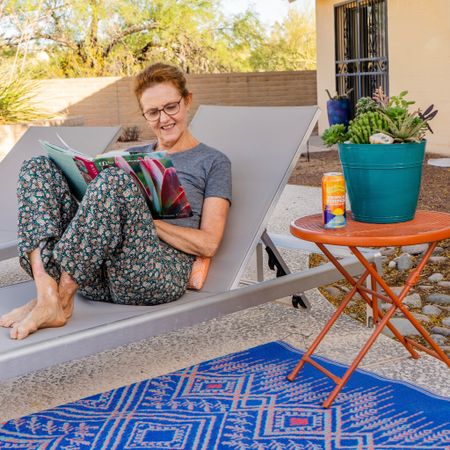 I LOVE lounging in my backyard near the pool with a relaxing book and a refreshing drink. This eco-friendly rug made from recycled materials adds the perfect pop of color in my backyard oasis and is also very easy to clean. #LTKSeasonal #competition  #LTKSeasonal