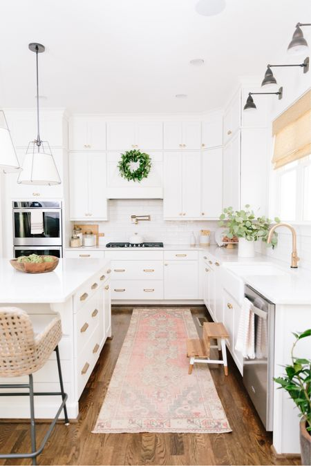 Light and bright kitchen for the win! I do love this view and the brass hardware is one of my favorite things we did! http://liketk.it/3hrB8 #liketkit @liketoknow.it #LTKhome #kitchen #whitekitchen #kitchenhardware #pendantlights