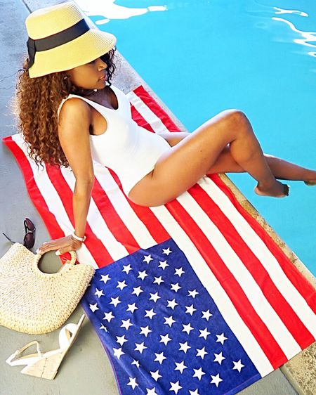 Celebrating the Fourth of July by hanging out by the pool in my cute white one piece swimsuit bathing suit and beach hat. How cute is  this ultra large flag beach towel with the American Flag. Don't forget to pair this with some cute white wedges heels that are strappy!  Have a fun 4th of July! 🇺🇸🎈🎉  http://liketk.it/2RFYJ #liketkit @liketoknow.it #LTKshoecrush Shop my daily looks by following me on the LIKEtoKNOW.it shopping app #LTKswim #LTKbump