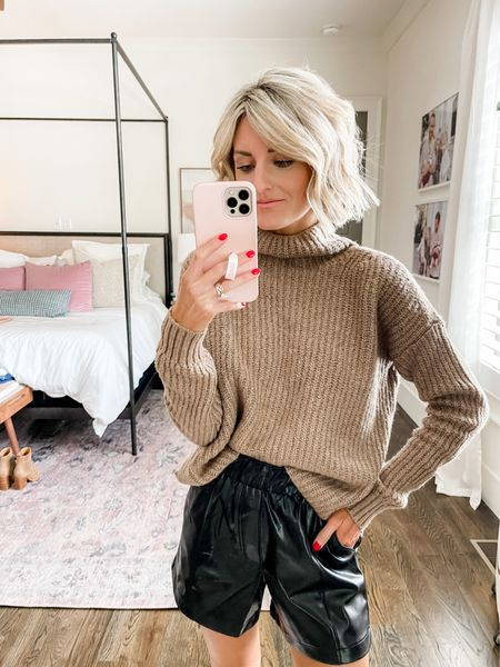 Pair a chunky sweater with a leather short for a great fall look!   #LTKstyletip