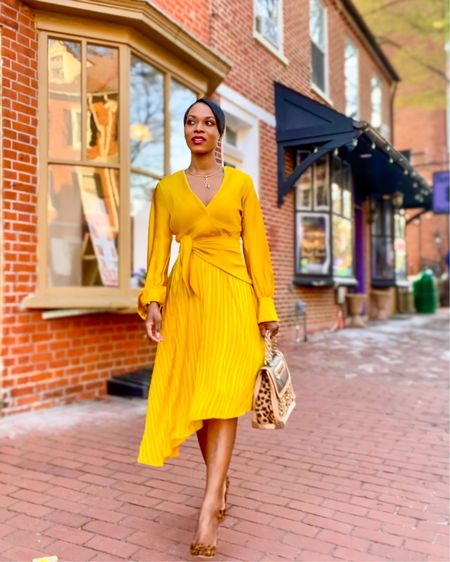 Several styles of dresses that are office-friendly staples are fitted pencil dresses, midi-length wrap dresses, or pleated dresses. . These types of dresses are classy and can easily transition from desk to dinner. . For an effortless 🌸springy workday look🌸 opt for a dress in vibrant color and complement with pointed toes nude pumps or kitten heel mules! . For today's outfit of the day I'm wearing a mustard yellow pleated wrap dress and styled it with leopard print pumps and an animal print satchel. . Mustard yellow is a beautiful color and it looks great on almost any skin tone.  .  So I did select some very stylish mustard yellow dresses similar to what I'm wearing on the liketoknowit shopping app.  . They appropriate for work and can be worn for other occasions. Follow me on the LIKEtoKNOW.it shopping app to get the product details! . Link in bio to learn more about my styling services⤴️ #anastaciastyling #anastaciastylingtips .  #liketkit #LTKunder100 #LTKworkwear #LTKstyletip @liketoknow.it http://liketk.it/3cnOG