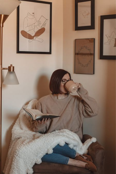 But first, coffee ☕️ Just a bit of cozying up in my favorite book nook for some reading and a cappuccino 📖 I love this space with the Gilmore Girls and bookish prints + my soft throw blanket and warm lighting 🙌🏼 It's my favorite place in my home! 🛋 http://liketk.it/35AEm @liketoknow.it #liketkit #StayHomeWithLTK #LTKhome