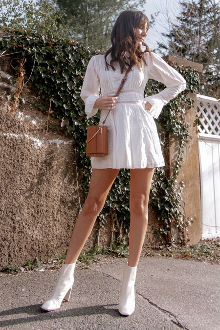 Shop spring outfits! Shop this white linen spring dress, white booties under $50, and brown bucket bag for super cute spring outfits #liketkit @liketoknow.it #LTKunder100 #LTKunder50 #LTKSeasonal http://liketk.it/38rzC