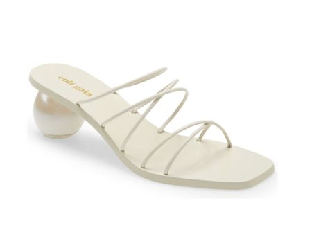 #nsale Cult Gaia off white slide sandals with a mid heel are still in stock in the Nordstrom Anniversary sale but there's only 1 or 2 left in some sizes so grab them now before they sell out & the sale ends 8/8. These super cute strappy cream Cult Gaia sandals are under $300 in the sale ($428 after sale). The sales open to everyone now so snap these modern beauties up before the N sale 2021 ends 2021: glamourandgains.com  #liketkit @liketoknow.it #nordstrom #cultgaia #cultgaiasandals