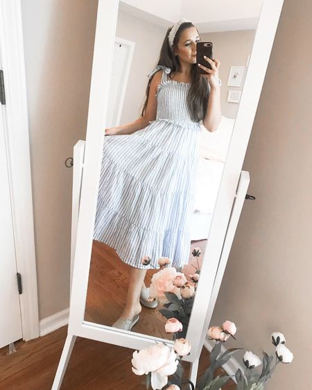 RESTOCKED: the prettiest midi dress ever! 🙌🏼 Love the blue and white palette and the ruffle and bow details! http://liketk.it/2TeMa #liketkit @liketoknow.it #LTKunder100 #LTKunder50 #LTKshoecrush