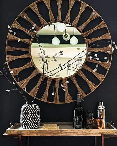 Round mirrors are one of my favorite things to decorate with. The bigger the better! This giant round rattan mirror is the perfect finishing touch above the industrial bar cart in my moody library.   #liketkit @liketoknow.it http://liketk.it/33i7X #LTKstyletip #LTKhome @liketoknow.it.home