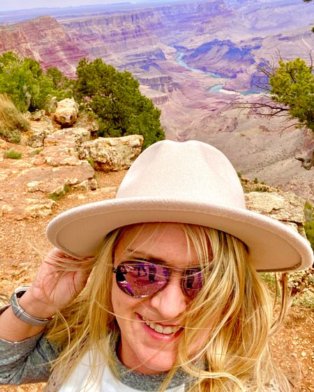 It may be hot in Arizona, but on the South Rim of the Grand Canyon with 40mph winds, you cannot tell it. I layered up in a baseball tee, sleeveless duster, hiking boots and jeans. Hat was great protection, but a chore to hang on to! Sunglasses were a must. What a beautiful site this was for a perfect back drop! #Ltkseasonal #competition #liketkit #LTKtravel #LTKstyletip #LTKshoecrush @liketoknow.it http://liketk.it/3gphp   You can instantly shop my looks by following me on the LIKEtoKNOW.it shopping app
