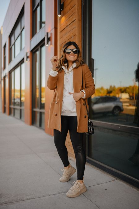 Comfy look but make it chic with these beige sneakers! They run tts and are so comfortable!! - fall fashion, Spanx leggings, quay sunglasses, camel coat, beige sneakers #ltkfall  #LTKHoliday #LTKshoecrush