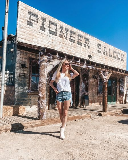 Roadtripping & fully embodying the Wild West vibes (minus a cowboy hat & Spurs).  📍 @pioneersaloonnevada go for the BBQ stay for the relaxed vibes.  White tee on sale @express #expressyou Jean shorts @femmeluxefinery #luxegal White ankle boots @justfabonline #justfabstyle  Sunglasses @jimmychoo   #saloon #lasvegas #goodsprings #ghosttown #ghosttowns #saloongirl #cowgirl #roadtrip #roadtripusa  #LTKunder50 #LTKsalealert #LTKtravel