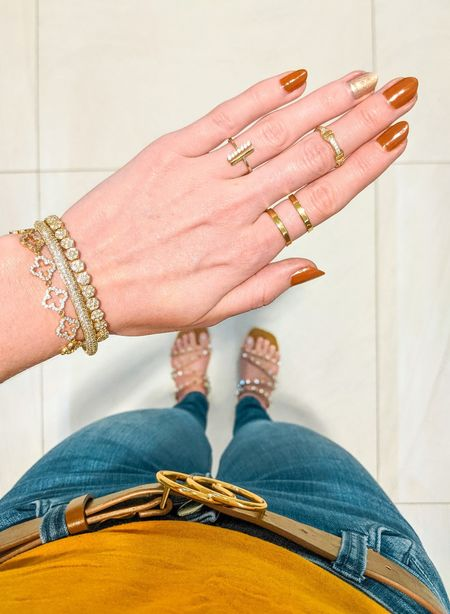Couldn't get my nails done, so I did them myself 💅 I finally decided on this brown and gold glitter combo and I LOVE it! I have also linked all other items in this photo. Gold bar ring, double bar ring, pave bracelets, stud sandals, brown belt.   #LTKSeasonal #LTKbeauty #LTKunder50