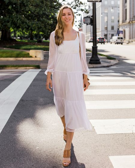 I have been dying to share this affordable white midi dress with you all, but it keeps going in and out of stock! It's finally back in a few sizes, and trust me—it's good. Size down one size for a more fitted look. I linked similar white summer dresses. My shoes are old (similar linked). ✨ http://liketk.it/3gDje #liketkit @liketoknow.it     White midi dress, white midi dresses, Nordstrom dresses, white summer dresses, long white dress, chiffon dress, long sleeve midi dress, long sleeve white dress, bridal dresses, bridal style