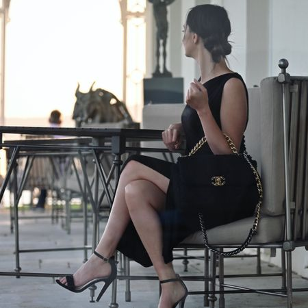 Summer evenings with Chanel 💗 Large Chanel tweed 19 with Vivienne Westwood dress. Effortless & classic.   #chanelbag #chanel19 #chanellover #blackdress #eveningstyle #eveningdress #eveningoutfit