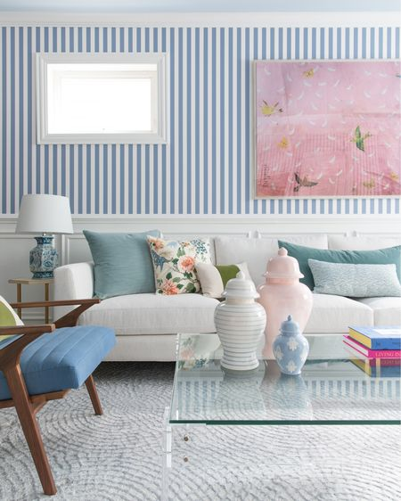 The Lo Home x Lemon Stripes ginger gars in our family room. Get more details of our blue stripe wallpaper, Crate and Barrel sectional, pink Natural Curiosities art, and chinoiserie lamps below!  #LTKstyletip #LTKunder100 #LTKhome
