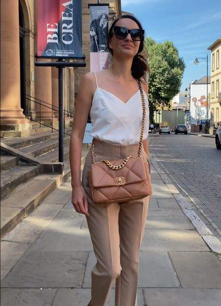 My favourite designer bag to head into the weekend with is the Chanel 19 small size 🙌 styled for a shopping trip with this white spaghetti strap camisole top and high waist camel trousers. Finish the look with some Louis Vuitton blacked out sunglasses for a chic look.   #chanelbag #chanel19 #chanel19flapbag #summeroutfit   #LTKHoliday #LTKstyletip