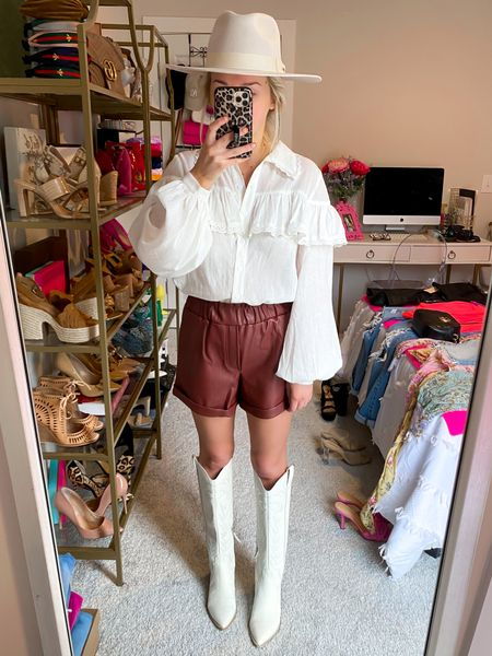 Chocolate brown leather shorts for $20! Fall 2021 trends: Chocolate brown leather.. Size: XS! Styled with white ruffle button down + white cowboy boots!   #LTKunder50 #LTKstyletip